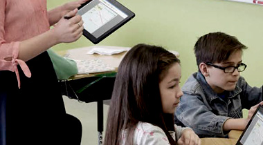 teacher using tablet in classroom