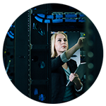Businesswoman pointing inside server room