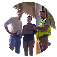 Supply chain personnel discuss shipping information to increase operational efficiency