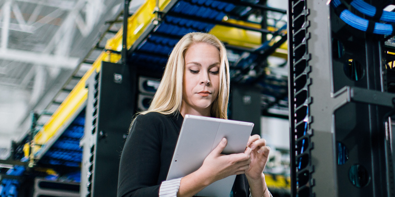 woman working on tablet in server room