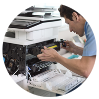 A printer technician checking out the HP Color LaserJet Enterprise Flow MFP M577z.