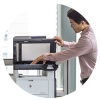 Business man closes scanner lid on HP LaserJet Pro MFP M521 printer