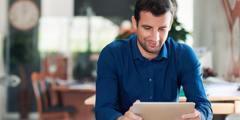 Man using tablet device in office
