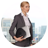 Business woman carrying Yamaha YVC 300 to meeting.