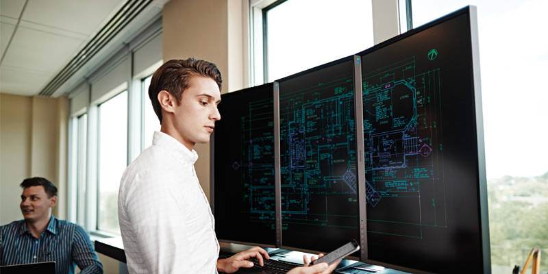 Business man using multiple displays