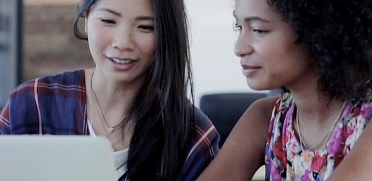 Two business women collaborate using Microsoft Office 365 applications