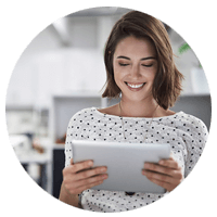 Smiling businesswoman using tablet computer
