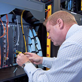 IT technician working on server in data center.