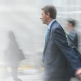blurry business man walking fast