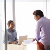 Man and woman having a conversation in an office