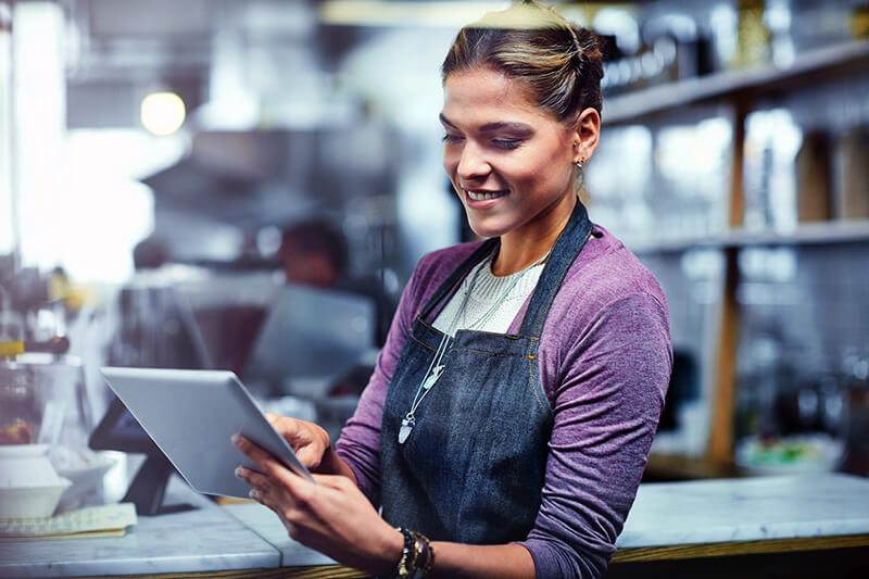 Store employee using tablet computer to capture client information