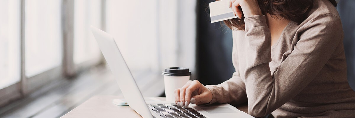 Women on computer using her credit card