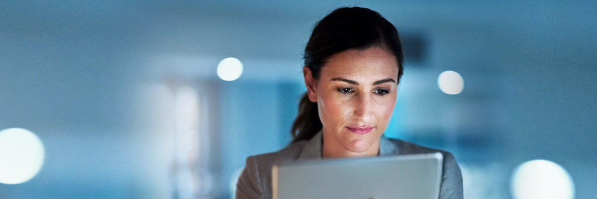 Business woman reviewing data off tablet computer