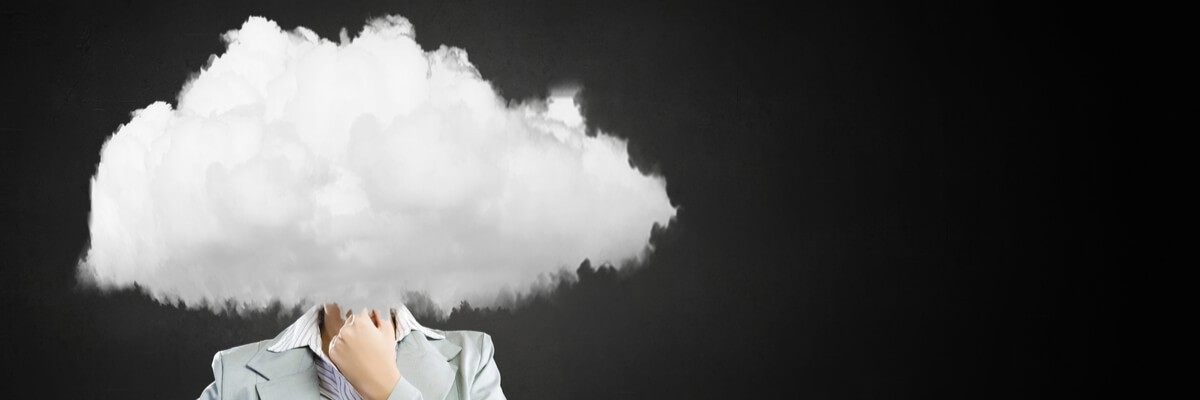 Rendering of businesswoman deep in thought with cloud over her head