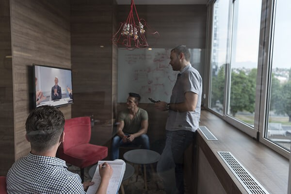 Group of people in business meeting using surface hub