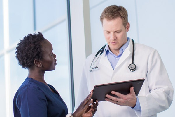 Dr. and Nurse have a discussion with tablet