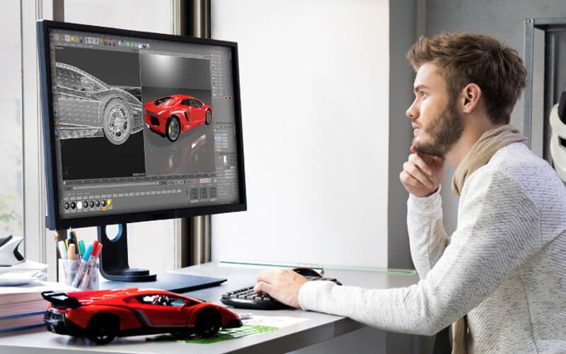 Designer using BenQ PD Series' DesignVue Monitors
