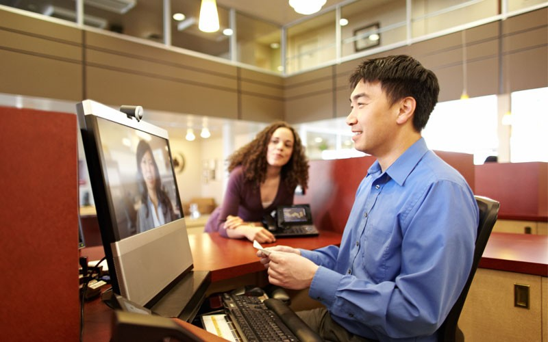 Employee using Cisco desktop and web cam device