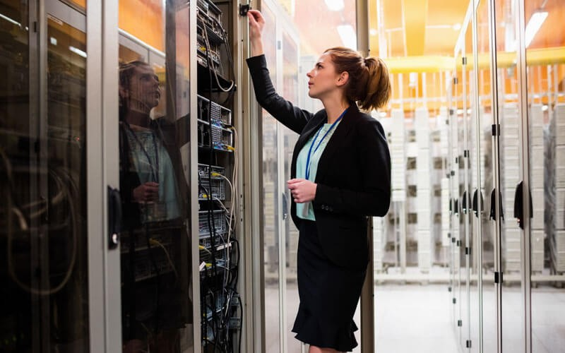 Woman working in server room