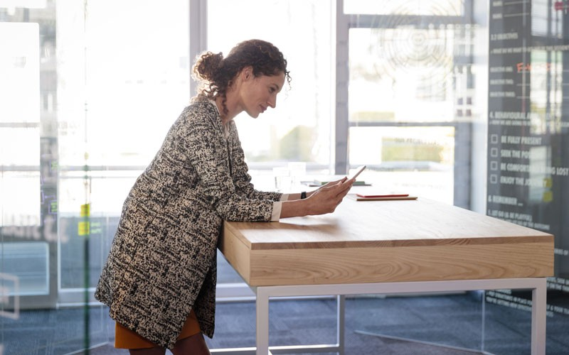 Woman using HPE tablet device