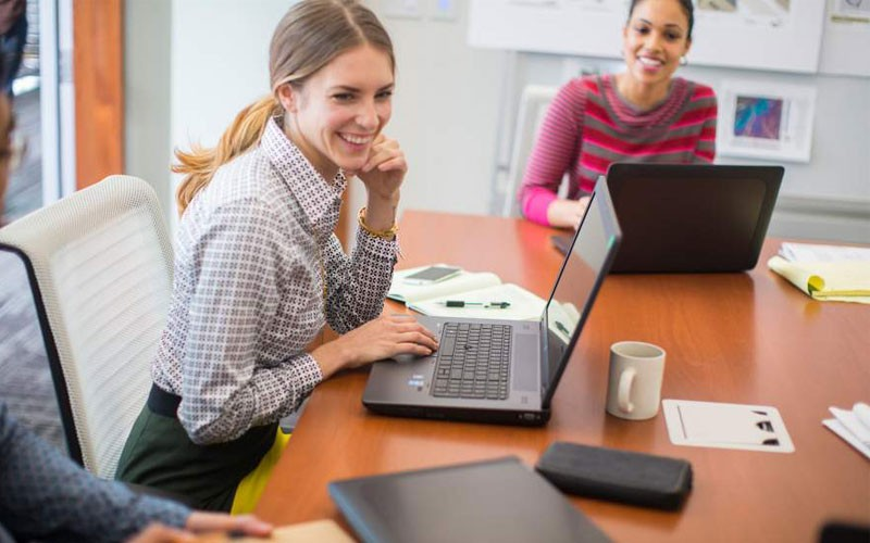 Business meeting with women using desktop devices