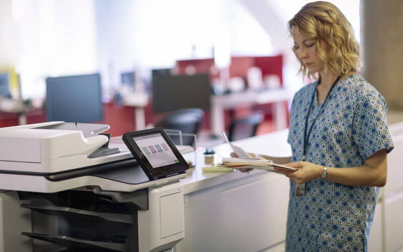 HP healthcare nurse using HP printer