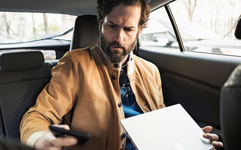 Man using Microsoft devices mobile