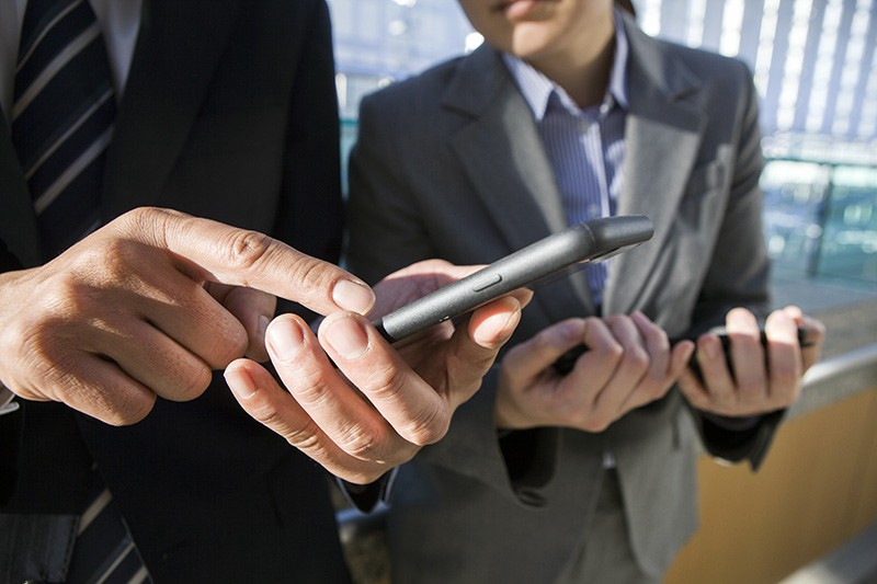 Business professionals on their smart phones