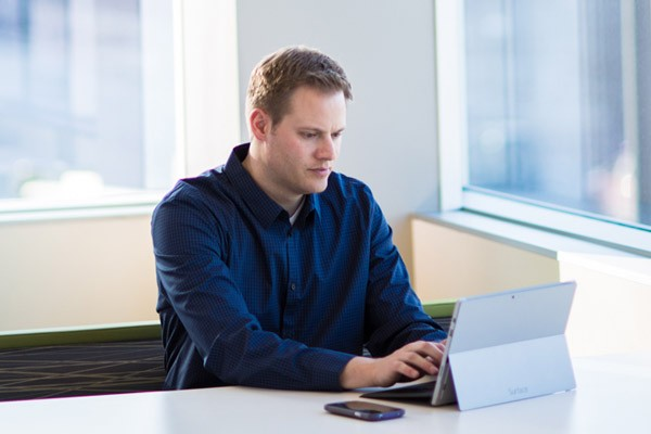 IT administrator using Microsoft Surface Pro with RSA's security portfolio