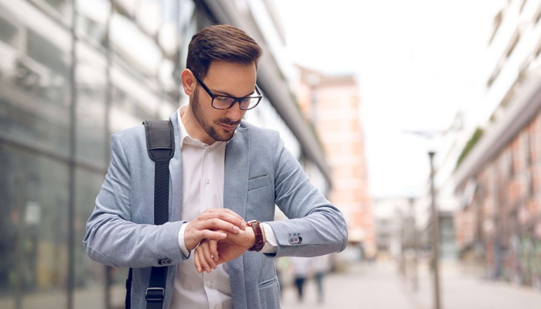 Business man checking messages on his smart watch